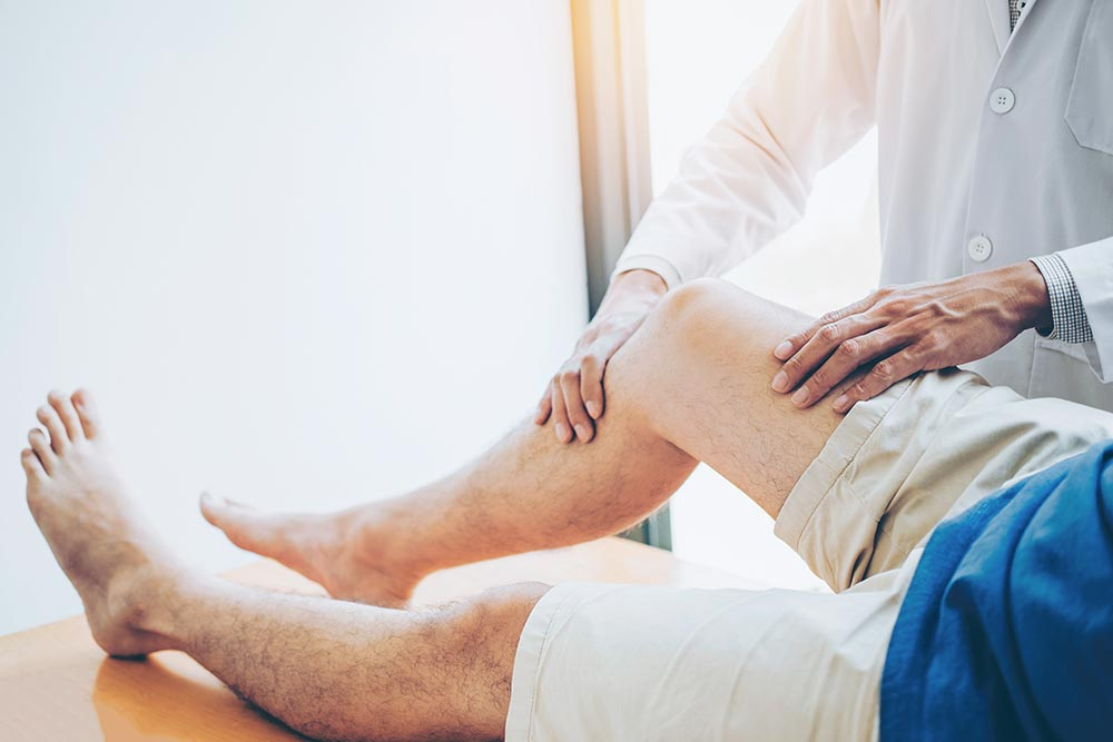 A man during his knee mobilisation treatment, Post-surgery rehabilitation In Townsville