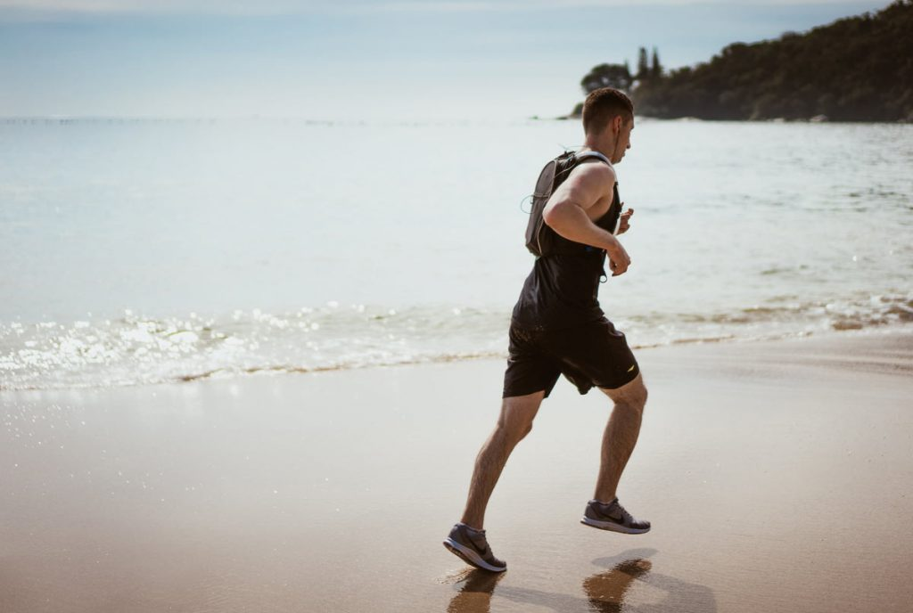 A man performing his routine exercise prescription in Townsville beach, Exercise Prescription Townsville